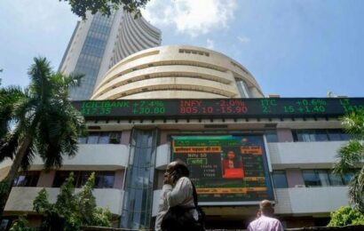 Sensex jumps 255 points to end at fresh record, Nifty claims 15,900 level