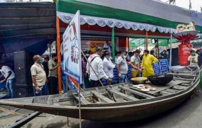 TMC protests over fuel price hike, supporters served food cooked on firewood oven