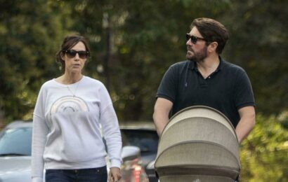 Alex Jones and husband Charlie Thompson enjoy sunny stroll with baby daughter Annie