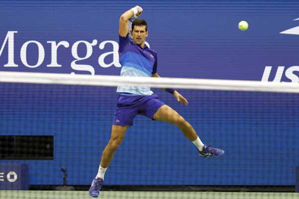 PIX: Djokovic takes first unsteady step toward calendar slam