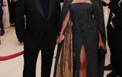 Regina King wore a sequin-lined Michael Kors pinstriped gown to the Met Gala